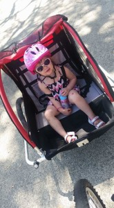 daughter in bike trailer